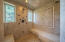 Spacious marble tile shower.