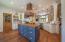 Custom wood pantry door and walnut countertop on the island