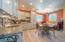 Custom built cabinetry and kitchen that is equipped with a sink, dishwasher and microwave.