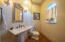 1/2 bath located in hallway adjacent to the front entryway of main house.
