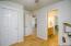 Closet and exit door in office/bedroom