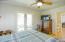 Patio doors to back yard in guest bedroom #`