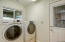 Laundry room between kitchen and garage