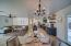 Dining space is open to kitchen and living with a french door to entertaining patio