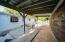 covered patio outside for entertaining and shaded hang area.