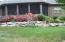 HUGE enclosed porch overlooking back yard