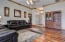 Living Room features beautiful rich exotic wood floors, crown molding, window bench, and feature fireplace.