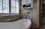 Decorative ceramic tile adorns this beautiful space.
