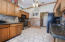 This Kitchen offers ample granite counter prep space and storage perfect for the chef in your home!