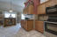 Kitchen/Eating space is quaint and inviting; with french door access to the beautiful outdoor living and entertaining features.