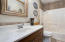 Full hall bath is well appointed with ceramic tile, cultured marble counter top, and tub shower.
