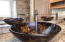 Beautiful vessel sinks and chrome faucets atop granite counter space.