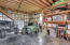 Inside barn outbuilding is concrete floor with built-in storage shelves. Great space for storing your tools and toys.