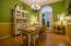Formal Dining Room with hardwood flooring.