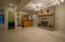 To the Basement: Large living area, wood burning FP, wet bar.