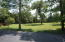Acreage to South of driveway