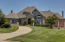 All brick and masonry stone exterior home on almost a full acre