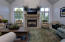 Hearth room with gas fireplace with cast concrete mantle