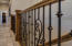Custom wrought iron railing at stairway to walk-out basement level