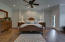 Master bedroom suite with gas fireplace, reading area and spacious bathroom