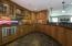 Wonderful wet bar in walk out basement with slate flooring