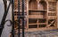state of the art wine cellar with wrought iron door
