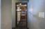 Wrought iron door to wine cellar room