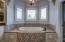 Beautiful jetted tub built in to alcove with exquisite tile detailing