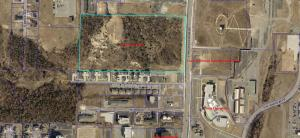 Aerial showing the 18 acres for sale and adjacent developments