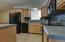 Beautiful cabinets, lots of counter space & Pass Thru Window
