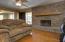 Living Room has gorgeous stonework gas log fireplace