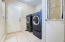 Large Laundry Room , half bath, deep mud room sink access from garage entry