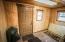 Mudroom with door to cellar