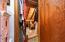 Access storage in attic through closet in storage room