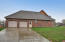 2-car garage with stamped concrete driveway and side entry door