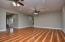 Spacious main living room has oak hardwood floors and double doors to back patio