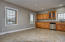 Huge kitchen has tiled floors, windows for natural light, and plenty of space for a large dining table