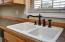 Double sink with bronze fixtures