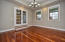 Sunken formal dining with Brazilian cherry hardwood floors and tray ceiling