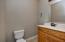 Half bath right off kitchen/living area