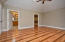 Large main floor master bedroom with high vaulted ceiling and oak hardwoods
