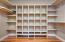 Absolutely massive walk-in closet with built-ins