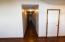 Hallway off of great room; left: bedroom, bathroom, bedroom; right: laundry; straight: master suite