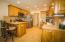 Kitchen with knotty alder cabinets