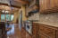 Gorgeous Granite Counter Tops and Notty Alder Cabinetry..