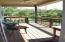 Covered main level deck w/spiral staircase to pool level