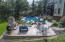 Adjoining patio w/fireplace to pool