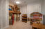 Extra room in the basement that is currently used as a children's play room. Features a great custom kids play house.