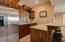 The wet bar includes a full size refrigerator and granite counter tops.