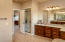 The walk-in shower and granite counter tops compete the spacious master bathroom.